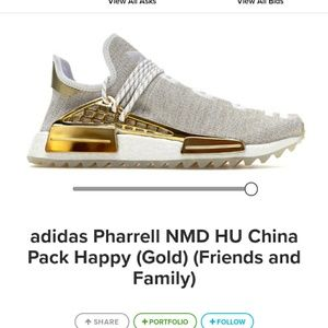 Pharrell williams gold and white